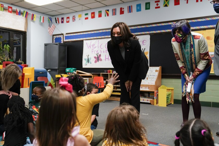 Vice President Kamala Harris and Rep. Rosa DeLauro talk with children at a child-development center in West Haven, Conn.