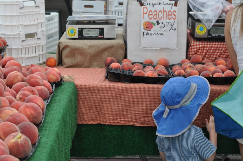 Peaches at the Tenerelli Orchards farmers market stand