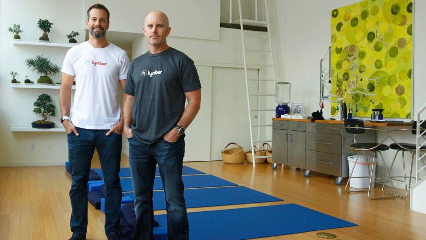 Chuck Phillips, left, and Doug Hecht, co-counded the app Lymber, which offers fitness classes at a number of health and fitness locations with no membership fee and dynamic pricing. The pair recently sold the company to Mindbody for an undisclosed sum.