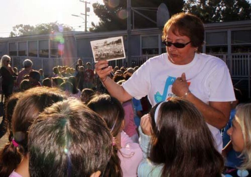 1Teacher Lorene LaCava shows the students the first school photo of BRE taken 60 years ago.  Pearl Preis photo