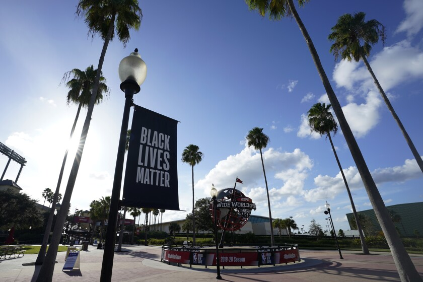A Black Lives Matter banner hangs outside the arena in Lake Buena Vista, Fla.