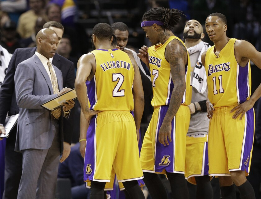 Lakers Coach Byron Scott draws a play for the Lakers during a timeout in the second half of a game against the Hornets.