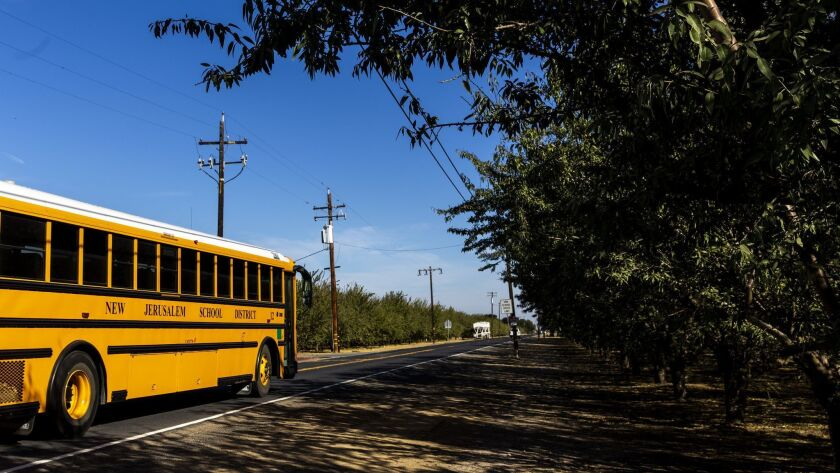 TRACY, CALIF. - OCTOBER 24: A New Jerusalem School District school bus departs from the Delta Chart