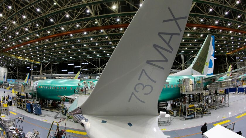 A Boeing 737 MAX airplane being built on the assembly line in Renton, Wash. American Airlines has changed its mind about reducing legroom on three rows of seats.