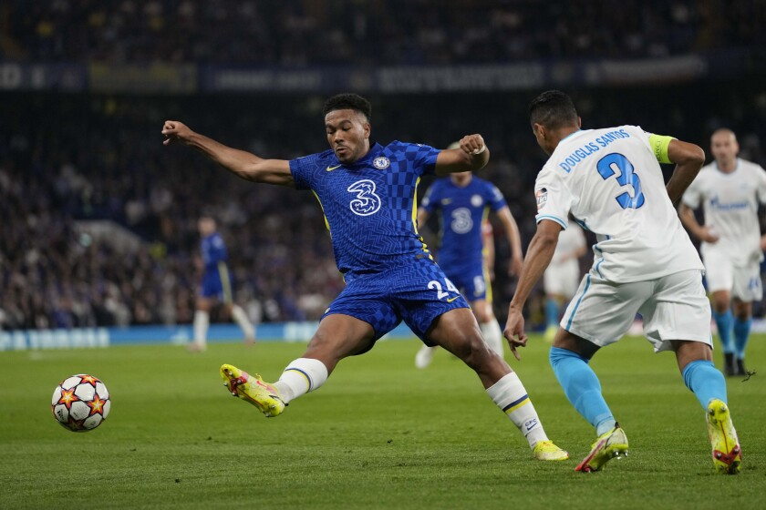 Chelsea's Reece James, left, challenges for the ball with Zenit's Douglas Santos during the Champions League Group H soccer match between Chelsea and Zenit St Petersburg at Stamford Bridge stadium in London Tuesday, Sept. 14, 2021. (AP Photo/Kirsty Wigglesworth)