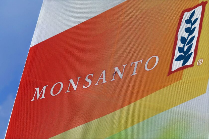 FILE - This Aug. 31, 2015, file photo, shows the Monsanto logo on display at the Farm Progress Show in Decatur, Ill. A former Monsanto Co. financial executive who tipped off regulators about the agribusiness giant's accounting practices involving rebates for its Roundup weed-killer will get nearly