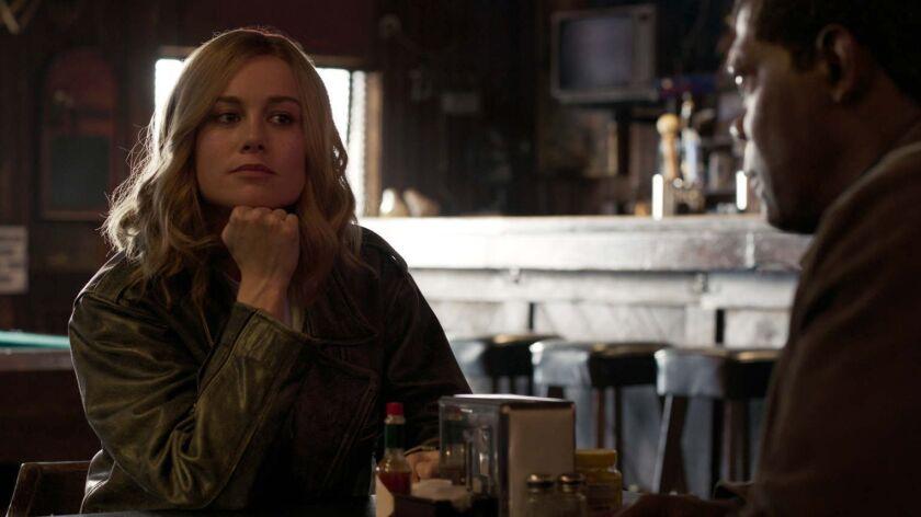 L to R: Captain Marvel (Brie Larson) and Nick Fury (Samuel L. Jackson) in a scene from Marvel Studi
