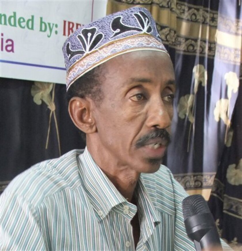 in this photo taken Thursday Oct, 14, 2010, veteran reporter Yusuf Ali Osman who has been serving as a director in Somalia's Ministry of Information, speaks during a meeting by Somali journalists in Mogadishu, Somalia. Yusuf Ali Osman, together with another journalist, has been killed in separate i