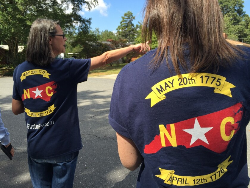 Canvassers from the Republican-backed Americans for Prosperity knock on doors in Charlotte.