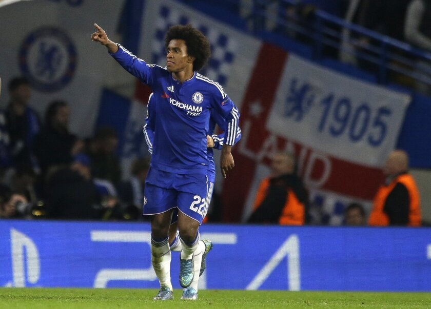 Chelsea's Willian celebrates after scoring his side's second goal during the Champions League Group G soccer match between Chelsea and Dynamo Kiev at Stamford Bridge Stadium in London,  Wednesday, Nov. 4, 2015. (AP Photo/Matt Dunham)