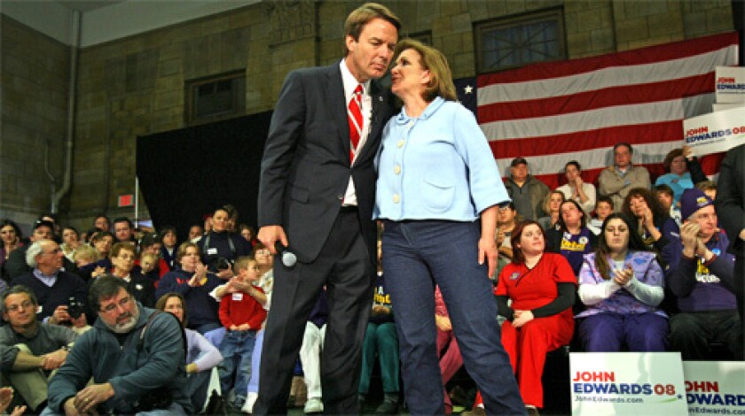 Democratic presidential candidate and former Sen. John Edwards of North Carolina takes a moment with his wife, Elizabeth, during a healthcare forum held at the Franco-American Centre in Manchester, N.H.