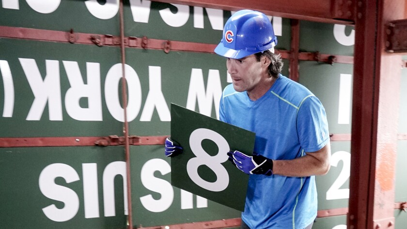 """The contestants must place numbers on the score board at Chicago's Wrigley Field in the season finale of """"The Amazing Race"""" on CBS."""