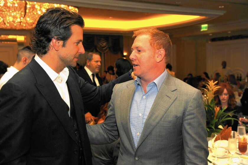 Actor Bradley Cooper, left, and Relativity Media chief Ryan Kavanaugh attend a Hollywood Foreign Press Assn. event in 2012.