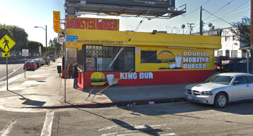 A man was shot in the hand while standing in the parking lot of Monster Burger in South Los Angeles.