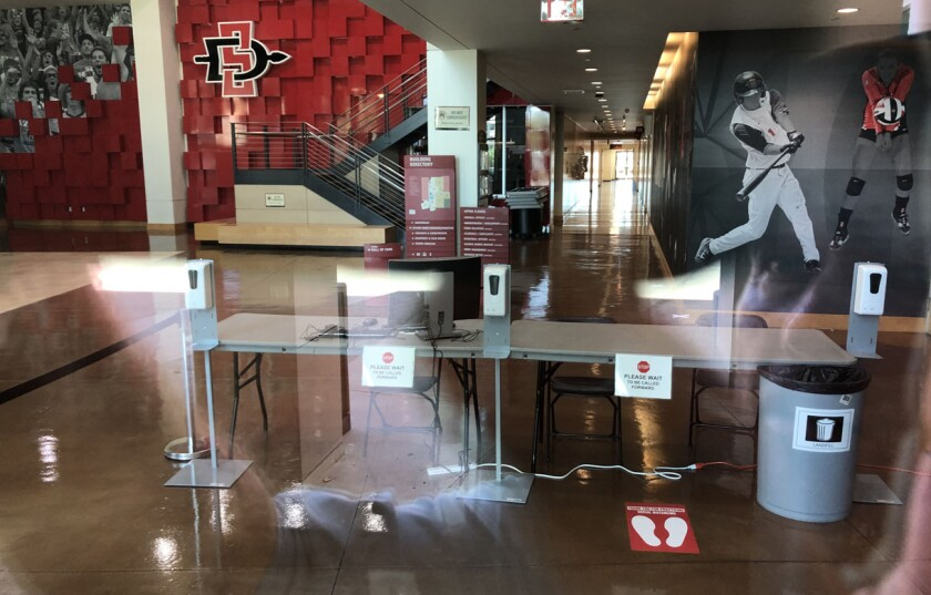 Those entering San Diego State's Fowler Athletics Center must be screened before proceeding into the building.