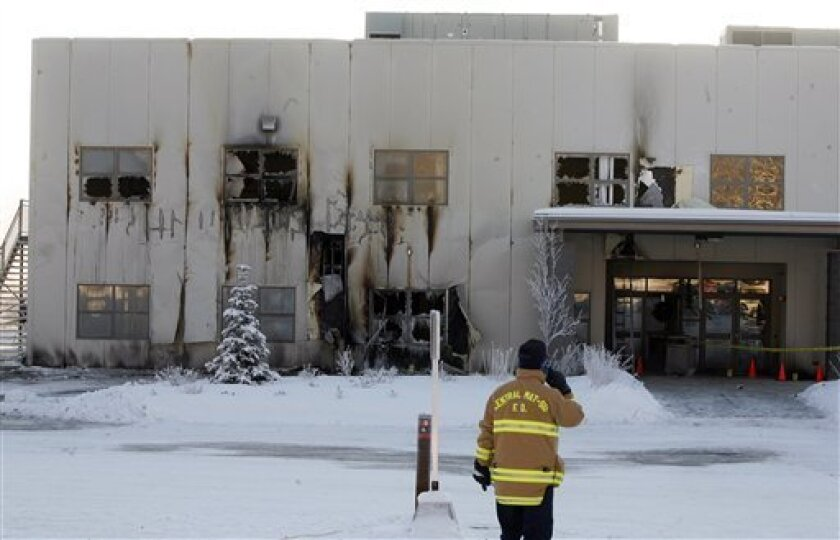 James Steele, fire chief for the Central Mat-Su Fire Department stands outside of the fire damaged Wasilla Bible Church in Wasilla, Alaska Saturday Dec. 13, 2008. Alaska Gov. Sarah Palin's home church was badly damaged in an arson fire. No one was injured in the fire, which was intentionally set while people, including two children, were inside. (AP Photo/Al Grillo)