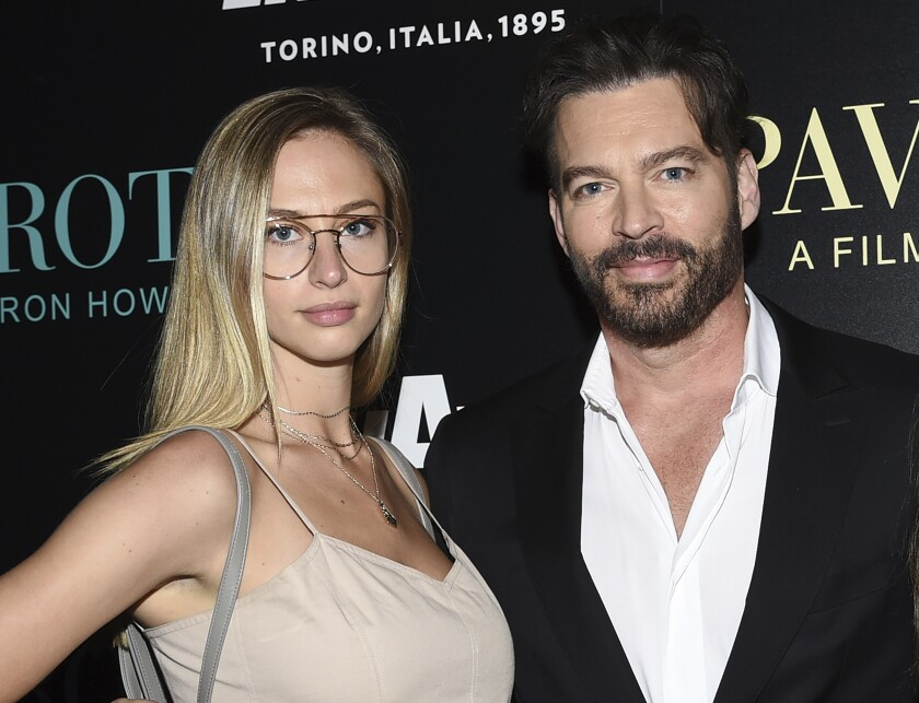 """FILE - This May 28, 2019 file photo shows Singer Harry Connick Jr. with his daughter Georgia at a special screening of """"Pavarotti"""" in New York. CBS will air a two-hour special, """"United We Sing: A Grammy Salute to the Unsung Heroes"""" to honor essential workers across America. The special will air June 21 and will follow host Connick Jr. and his filmmaker-daughter Georgia on road trip celebrating and thanking essential workers during the coronavirus pandemic. (Photo by Evan Agostini/Invision/AP, File)"""