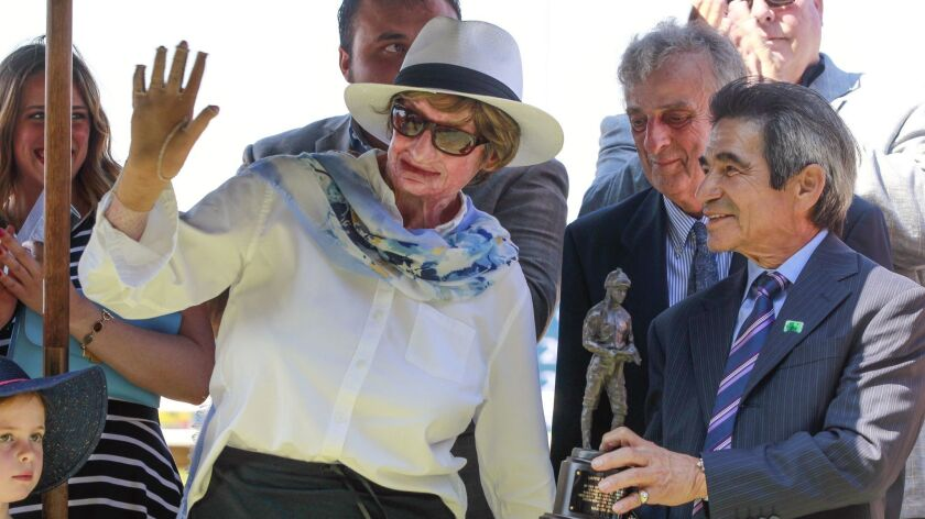 Horse trainer Martine Bellocq, shown in August 2018 at Del Mar with Laffit Pincay Jr., right, and her husband Pierre, behind Pincay, recently won her first race in nearly three years.