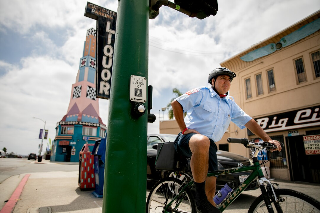 Christopher Castor, 56, who pilots the number 7 bus that traverses University Avenue, rides his bike to work.