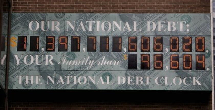This 2009 photo shows the National Debt Clock in New York City. The national debt has more than doubled since then.