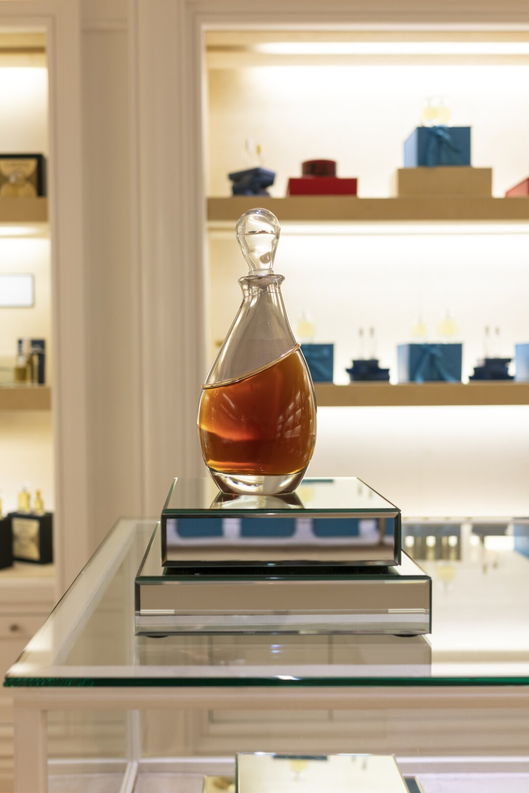 A glass perfume bottle on display in a store