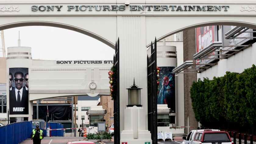 FILE - In this Thursday, Dec. 18, 2014 file photo, cars enter and depart from Sony Pictures Entertai