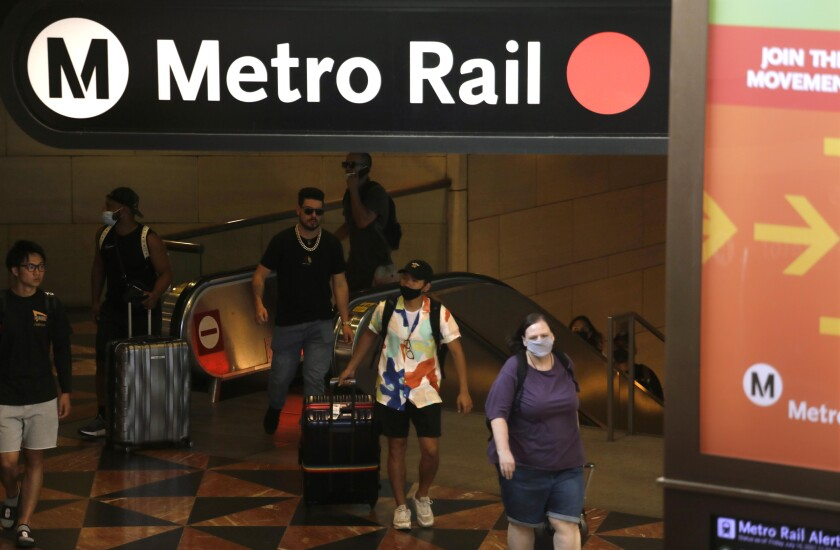 Travelers exit a Metro Rail line in Los Angeles.