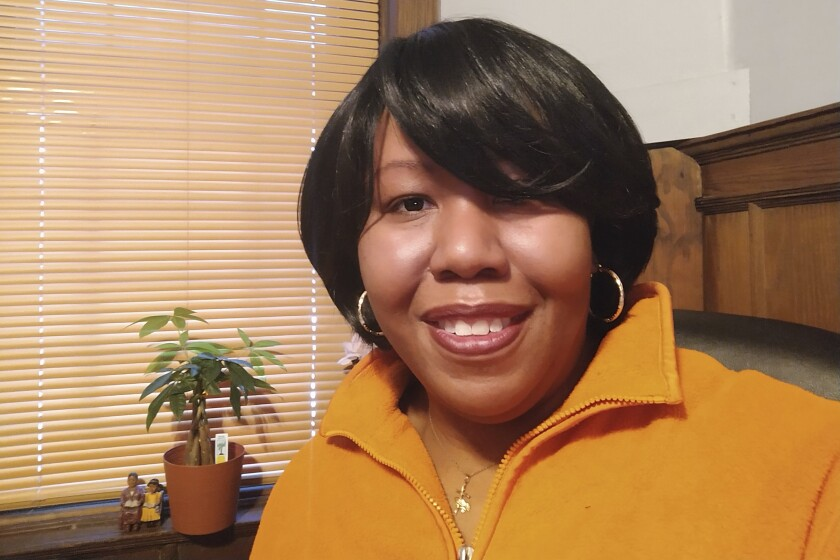 """This February 2021 photo shows Stacy Hill, 48, of Philadelphia. After she lost her job and health insurance, a colonoscopy revealed two growths that were caught before they turned cancerous. """"I was shocked,"""" Hill said. """"I'm a proactive-type person so I was glad to know."""" Doctors also helped her enroll in Medicaid, """"so now I have medical insurance"""" and can continue getting cancer screenings, she said. (Stacy Hill via AP)"""