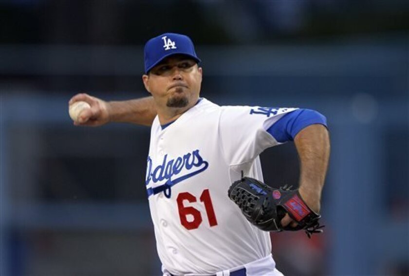 Los Angeles Dodgers starting pitcher Josh Beckett throws to the plate during the first inning of their baseball game against the Arizona Diamondbacks, Tuesday, May 7, 2013, in Los Angeles. (AP Photo/Mark J. Terrill)