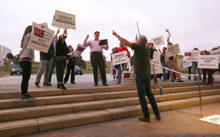 Newport Beach City Hall residents protest a proposed homeless shelter