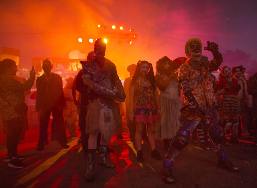 Monsters wait for guests at the Queen Mary's Dark Harbor haunt, which is canceled for 2020.