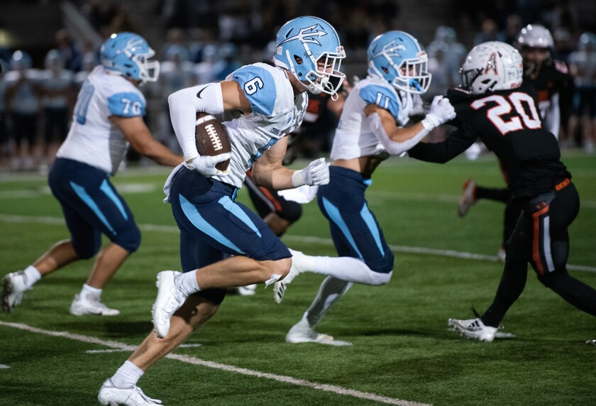John Humphreys races to the end zone to complete an 80-yard touchdown catch in Corona del Mar's Sunset League opener at Huntington Beach on Thursday.