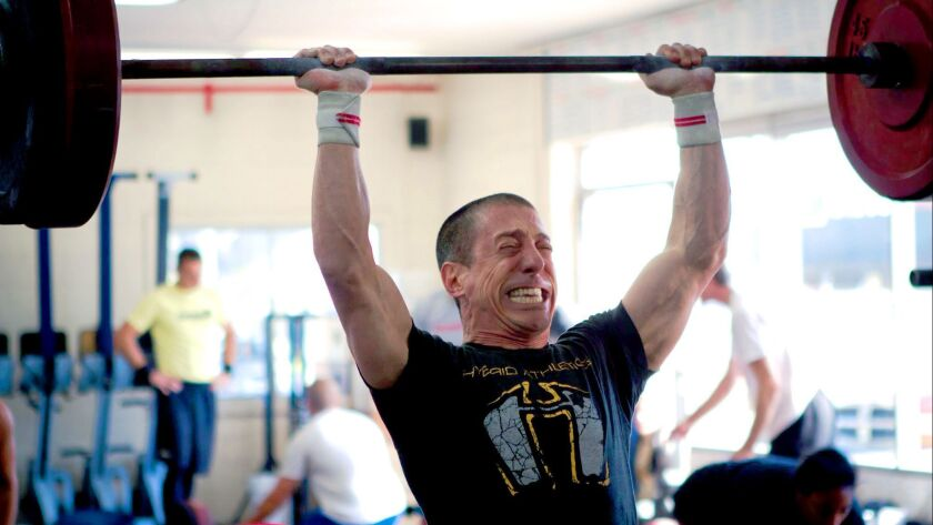 The Whole Life Challenge founder Andy Petranek during a workout.