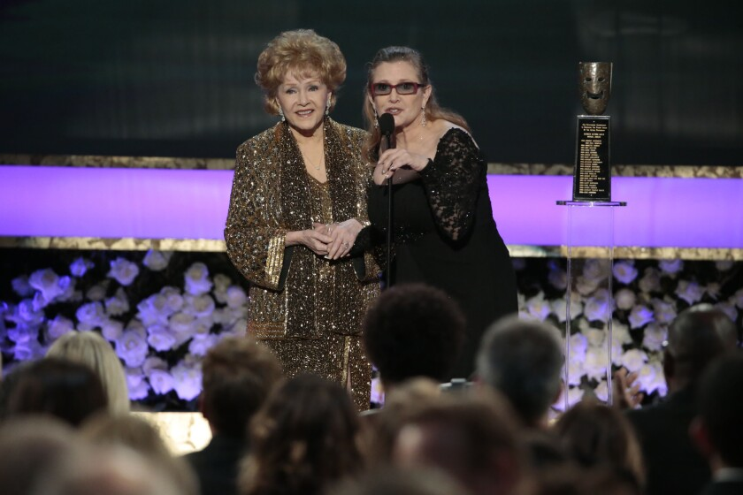 Carrie Fisher presents her mother, Debbie Reynolds, the Life Achievement Award at the 21st Screen Actors Guild Awards at the Shrine Auditorium in Los Angeles on Jan. 25, 2015.