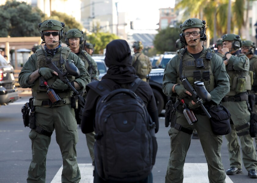 SWAT officer from the San Diego Police Department block protestor access on the corner of 9th and E Street in downtown.