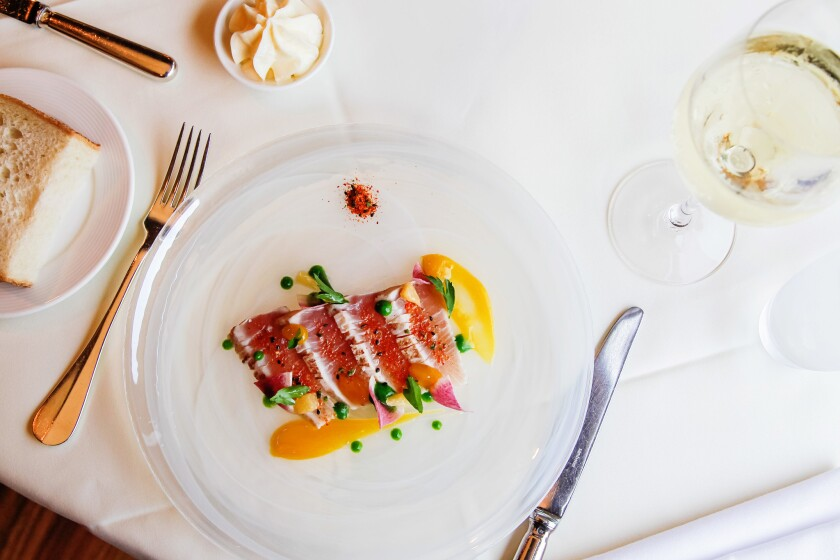 Does food taste better on a white tablecloth? The Hamachi Tataki with Meyer lemon puree, parsley, radish and Togarashi at The WineSellar & Brasserie.
