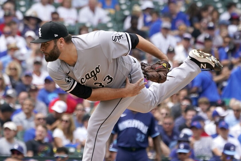Chicago White Sox starting pitcher Lance Lynn follows through during the first inning of a baseball game against the against the Chicago Cubs, Friday, Aug. 6, 2021, in Chicago. (AP Photo/Charles Rex Arbogast)
