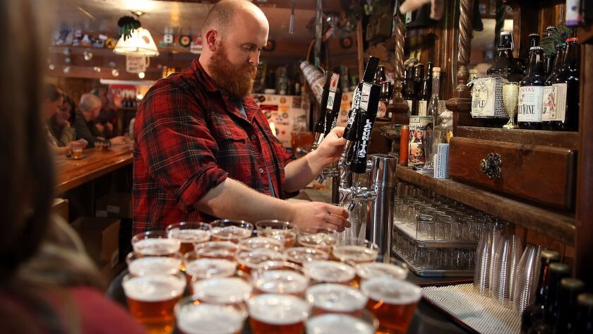 Tim Decker pours beer samples during a brewery tour at Lagunitas Brewing Company in Petaluma, Calif., in 2014.