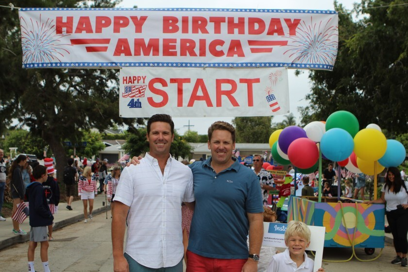 Russ and Scott Murfey, organizers of the Bird Rock Fourth of July community parade, get ready for the start in 2019.