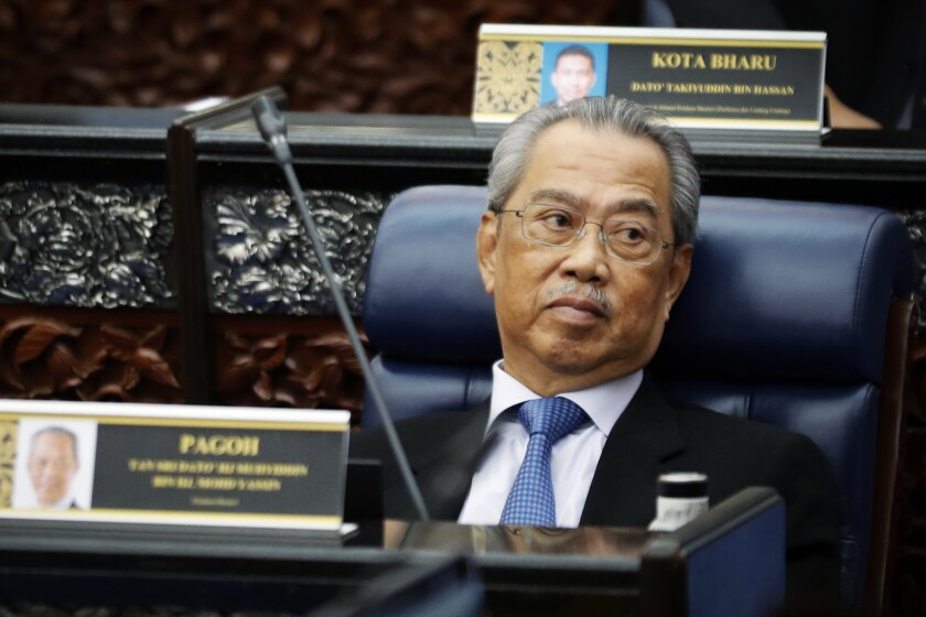 FILE - In this July 13, 2020, file photo, Malaysian Prime Minister Muhyiddin Yassin attends a Parliament session at lower house in Kuala Lumpur, Malaysia. Embattled Prime Minister Yassin acknowledged Friday, Aug. 13, 2021, he may have lost majority support in Parliament but said he will seek bipartisan support to keep his government from collapsing and promised to call for election next year. (AP Photo/Vincent Thian, File)