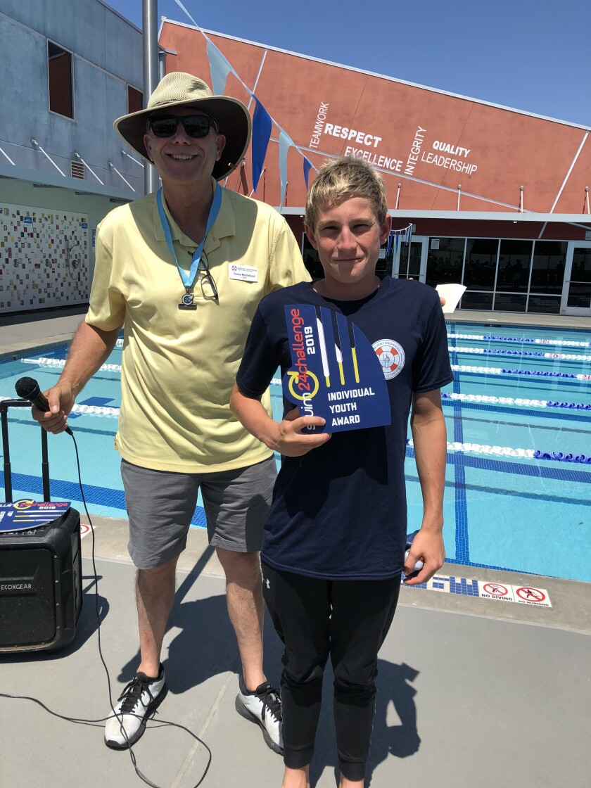 Corey McClelland, president and CEO at Prevent Drowning Foundation presents the top youth award to Rancho San Dieguito swimmer Sébastien Wenger.