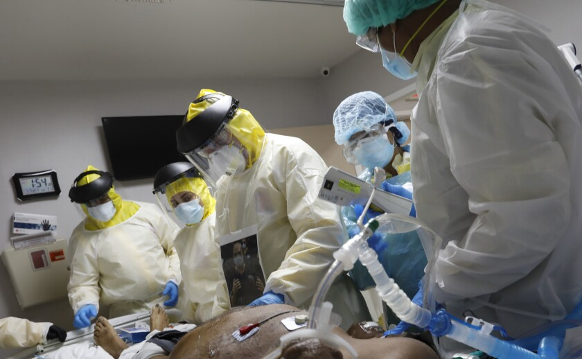 Putting a patient on a ventilator is a last resort. Dr. Joseph Varon, center, does emergency treatment on a patient.