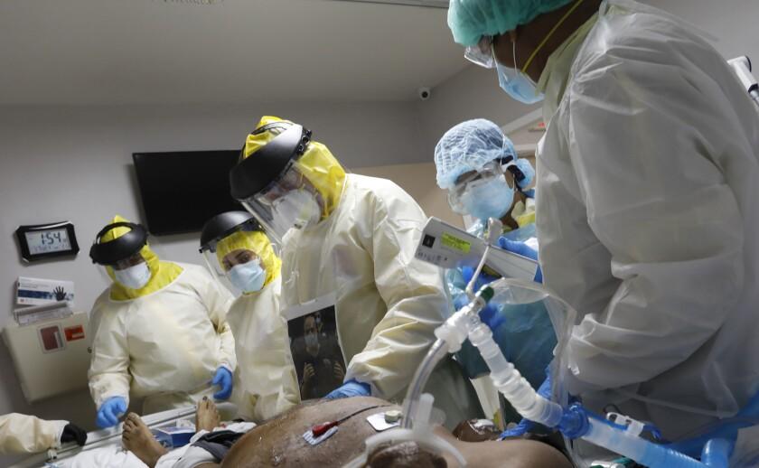 Dr. Joseph Varon treats a COVID-19 patient on a ventilator in Houston.
