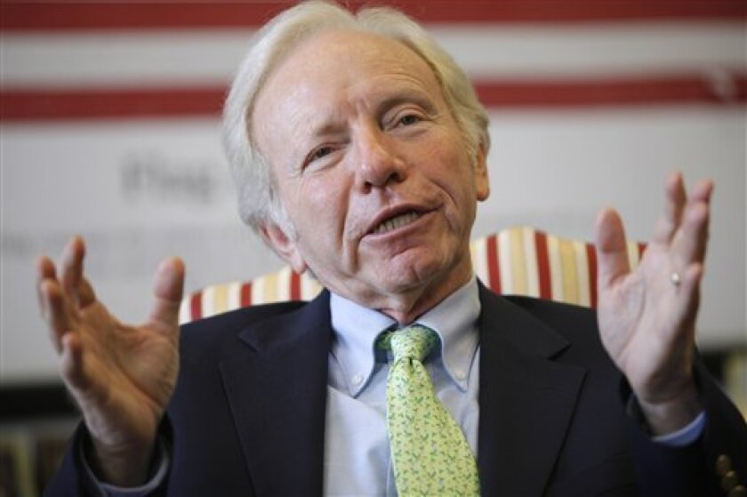 FILE - In this July 24, 2009, file photo, Sen. Joseph Lieberman, I-Conn., gestures during an interview with The Associated Press in Washington. Lieberman, an independent senator the Democrats are counting on as they consider outflanking the GOP on health care legislation showed signs of wavering Su