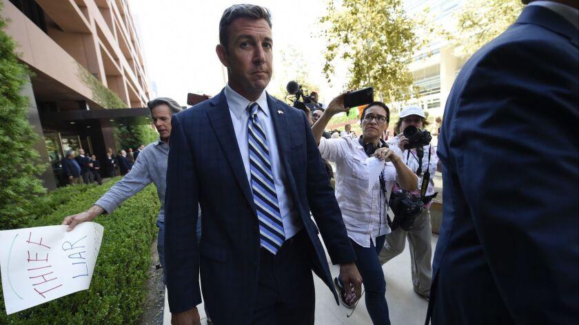 U.S. Rep. Duncan Hunter leaves an arraignment hearing Thursday, Aug. 23, 2018, in San Diego. Hunter