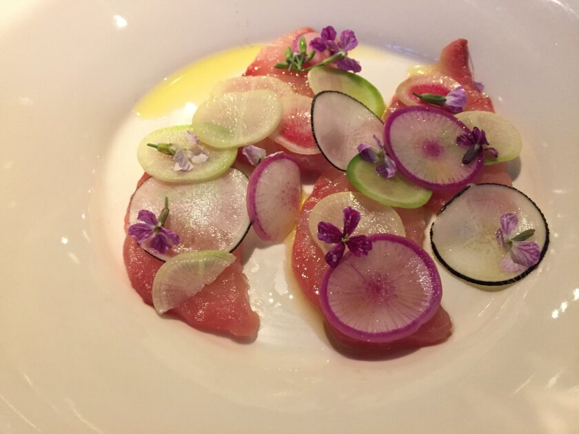 Yellowtail and radishes course on the chef's tasting menu at Juniper & Ivy.