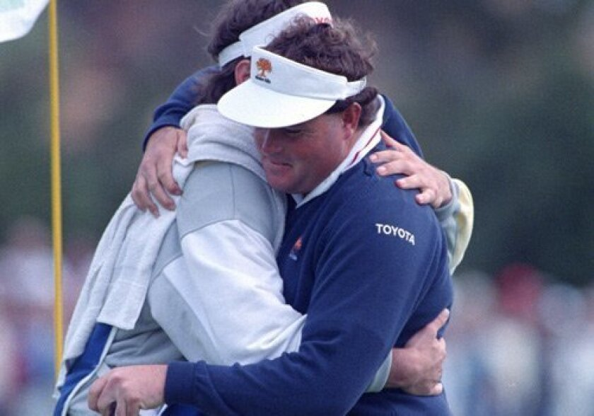 Greg Twiggs (right) hugs his caddie at the 18th hole after winning the Shearson Lehman Hutton in 1989.