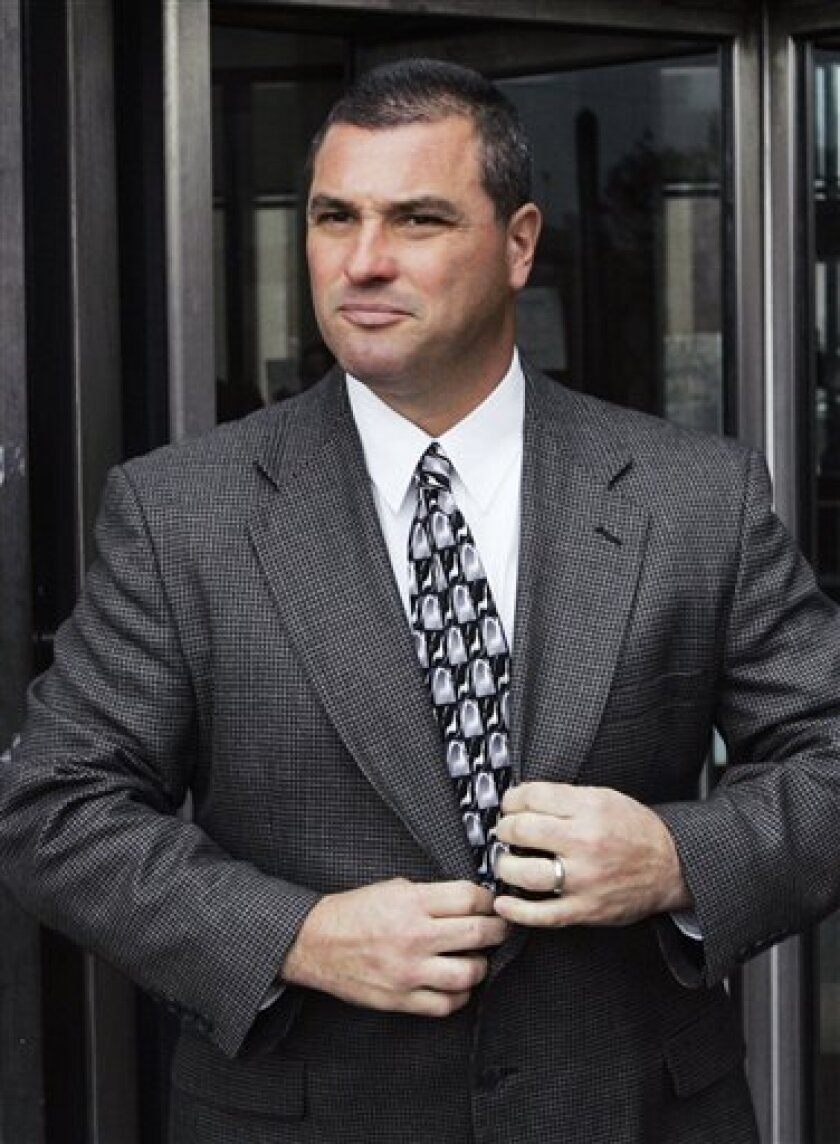 FILE - In this Nov. 14, 2006 file photo, Chicago Police Officer Jerome Finnigan leaves the Cook County Criminal Courts Building in Chicago. Finnigan, who who admitted stealing hundreds of thousands of dollars from suspected drug dealers and ordering another officer killed, was sentenced Thursday, Sept. 8, 2011, to 12 years in prison. The sentence follows the former officer's guilty plea in April to ordering the hit and a tax charge in federal court. (AP Photo/Charles Rex Arbogast, File)