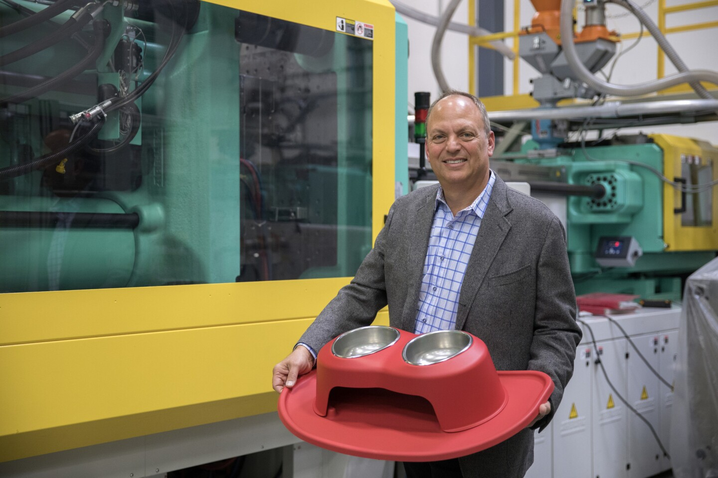 Founder and CEO David MacNeil holds a PetComfort ergonomic pet bowl on Feb. 27, 2018, at WeatherTech in Bolingbrook.
