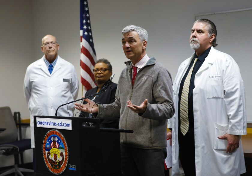 Medical Director Eric McDonald answers questions from news reporters.